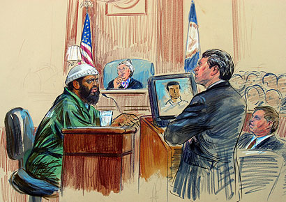 An artist's rendering of Zacarias Moussaoui being cross-examined yesterday by prosecutor Robert Spencer.