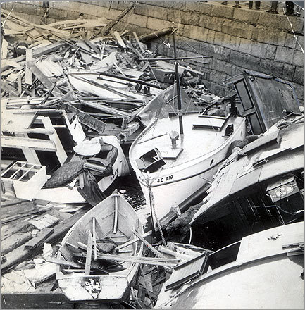Boats destroyed in the hurricane were piled against the sea wall in Plymouth Harbor. The storm caused significant storm surges, including 17-foot surges along the Connecticut and Rhode Island coasts.