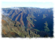 The inland area of the western part of Kauai is dominated by the Waimea Canyon and Koke'e State Park. Dubbed as the 'Grand Canyon of the Pacific' by Mark Twain, Waimea Canyon reigns supreme. The coloring of its inner walls and the roadside lookout views into the canyon are spectacular. Courtesy of BestPlacesHawaii.com
