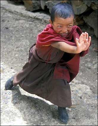 A very young monk practices his kung fu moves.