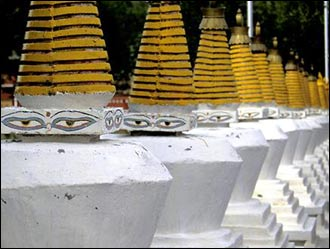 A long row of stupas adorn a local park in Litang.