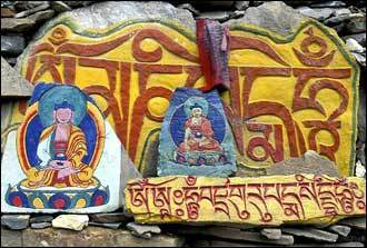 Painted mani stones line the path to the monastery in Litang.