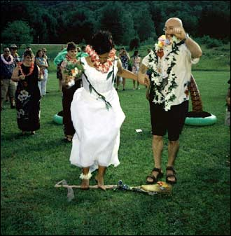 Simone and Tom were married on July 17, 2004 in Plymouth, New Hampshire. Here, they jump on the broom to signify the start of a new life together.