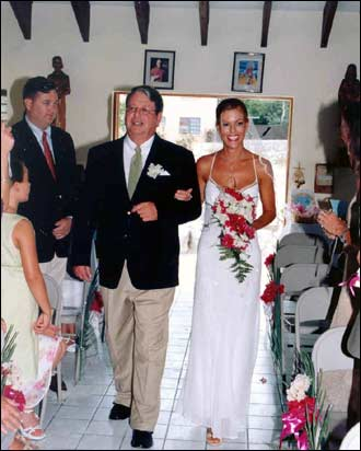 Tiffany and her father walk down the island chapel aisle. Guests flew in from all over the United States and Canada including Los Angeles, San Francisco, Chicago, New York, Palm Beach and Vancouver, BC, as well as the bride and groom's hometown of Boston and filled the resort for the wedding week.