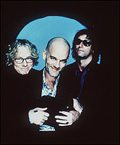 R.E.M. (from left) Mike Mills, Peter Buck, and Michael Stipe