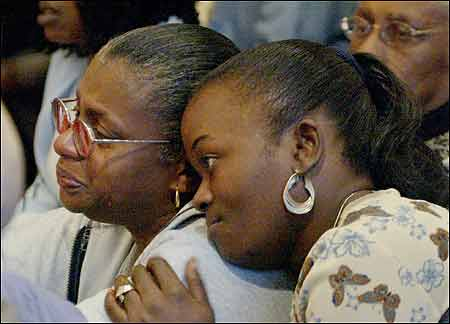 Tanya Leary (right) comforted Pam Jones, the mother of Chauntae Jones, yesterday at Suffolk Superior Court in Boston, where Lord Hampton, 25, was convicted of killing Chauntae and her unborn baby.