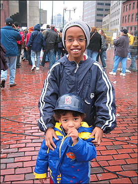 Jed Hresko emailed this picture featuring two young Sox fans, one shy and one happy, on City Hall Plaza.