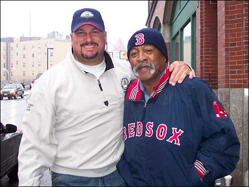Former Sox pitchers Jim Corsi and Luis Tiant head into Fenway Park to take part in the parade.