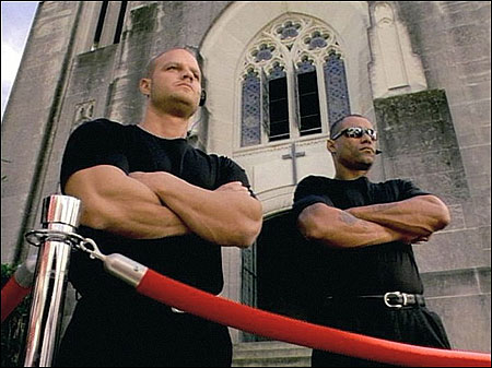 The rejected ad from the United Church of Christ depicts two bouncers standing guard outside an unnamed church and choosing who will be allowed to enter. Among those turned away are two men holding hands and several nonwhite people.