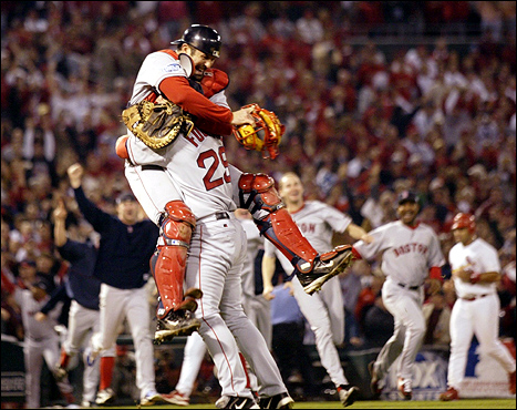 Oct. 27: At last! For the first time in 86 years, the Red Sox won the World Series, taking the final game 3-0. Boston catcher Jason Varitek, left, hugged pitcher Keith Foulke as they celebrated in St. Louis.