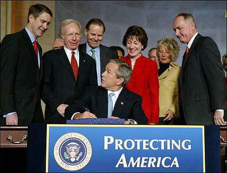 President Bush, joined by members of Congress and his Cabinet, signed the intelligence reform bill into law in Washington on Dec. 17. ''It will enable us to better do our duty,'' Bush said.