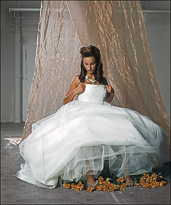 Gown with tulle-and-lace skirt and English-net bodice by Vera Wang, $9,900 at Vera Wang. Suede mules by Prada, $345 at Neiman Marcus, Boston. Pearl, willow-bark, and citrine necklace by Simon Alcantara, $3,100; gold-and-diamond engagement ring, $1,750, and wedding band, $1,500, both by Alishan; all at Persona Jewelry.