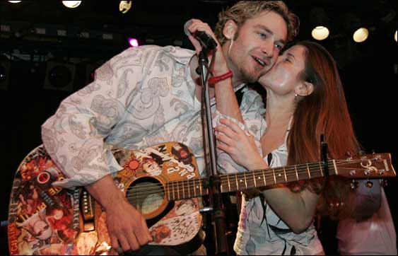 Pitcher Bronson Arroyo and a fan at 'Hot Stove, Cool Music' at the Paradise on Sunday night.