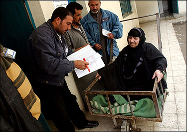 An Iraqi woman was taken in a cart to vote at a polling place yesterday in the Sadr City neighborhood of Baghdad.