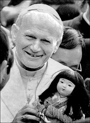 JAPAN - The pope held a traditional Japanese doll presented to him during a visit to Memorial Cathedral in Hiroshima in February 1981. The pope declared: ''War is the work of man. War is the destruction of human life.''