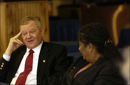 Best-selling novelist Tom Clancy and poet Marilyn Nelson at an Operation Homecoming workshop in Virginia. Clancy regards writing as a cash cow, not a catharsis: ''I'm not a shrink, I'm not a priest. 'Catharsis' sounds like some kind of Greek drink.''