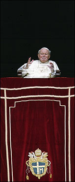 Amid renewed reports that his health was deteriorating, Pope John Paul II blessed pilgrims in St. Peter's Square from his window on March 23 in his second public appearance since leaving the hospital.