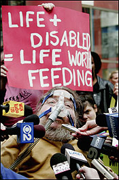 Disability activist Mark Karner speaks with reporters on Tuesday during a rally in Chicago organized by the group Not Dead Yet to protest the removal of Terri Schiavo's feeding tube.