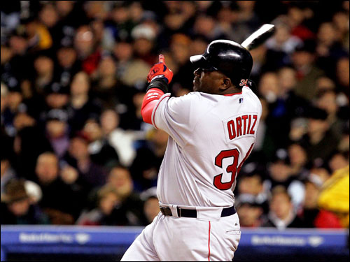 Red Sox designated hitter David Ortiz hits a double in the second inning of Sunday's season opener at Yankee Stadium.