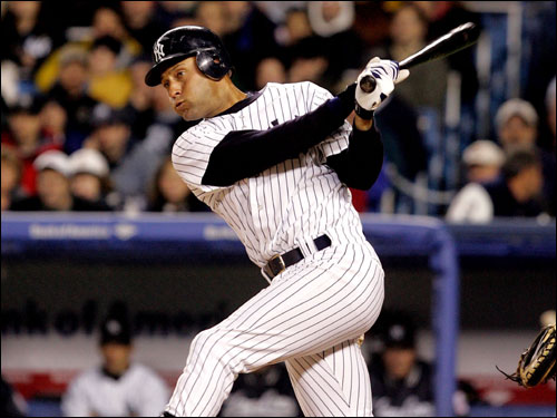 Yankee shortstop Derek Jeter hits a double off of David Wells in the third inning.