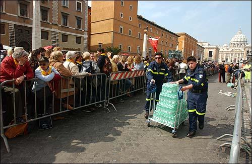 Officials handing out water bottles
