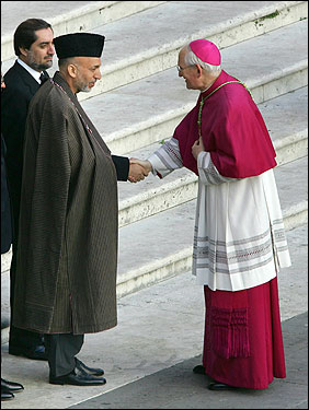 Bishop James Harvey (right) welcomed Afghan President Hamid Karzai before the funeral of Pope John Paul II in St Peter's Square at the Vatican City.