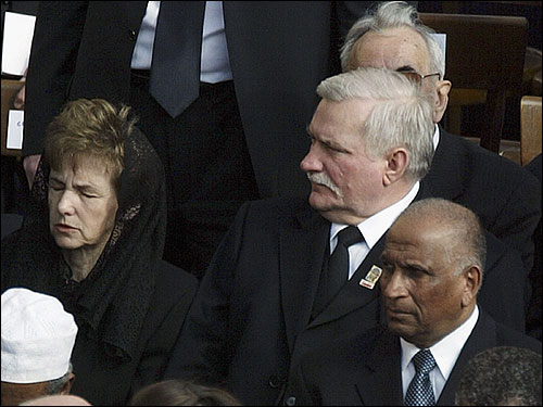 Former Polish President Lech Walesa (right center) attended the funeral.