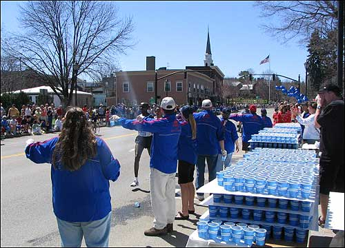 Elite runners grabbed water as they moved through town.