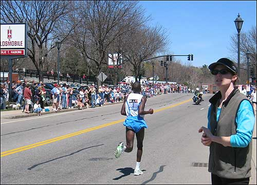 Benjamin Kosgei Kimutai of Kenya tore through town.
