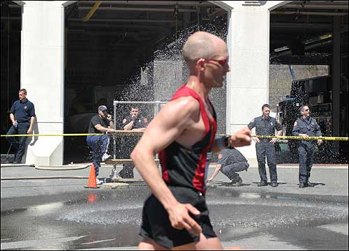 Firefighters helped a runner cool down.