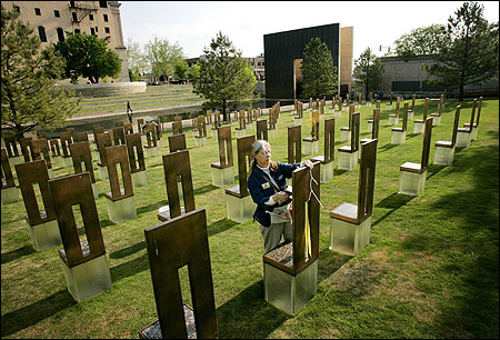 Jane Thomas, a staff member at the Oklahoma City National Memorial, yesterday tended to one of the chairs representing the 168 people killed in the 1995 bombing of the Murrah building.