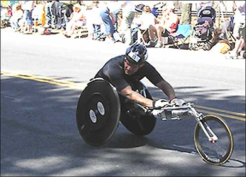 A wheelchair racer looked over his shoulder at the competition.