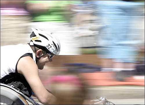 A wheelchair racer sped past mile 20, right before Heartbreak Hill.
