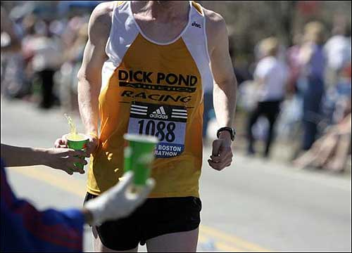 A runner's thirst was quenched as he approached Heartbreak Hill.