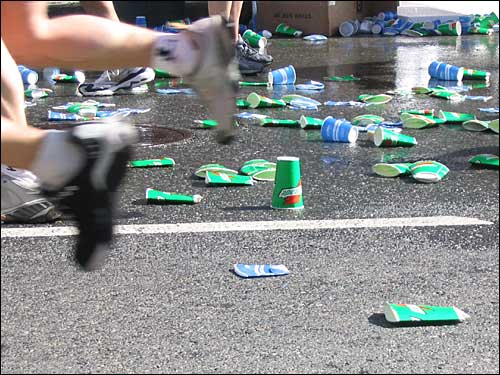 By the end of the race runners faced an obstacle course of discarded cups.