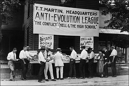 HEARTS AND MINDS. Evolution is so embattled, Michael Ruse argues, because Darwinians have historically tried to compete with religion. Above: The Anti-Evolution League holds a book sale in Dayton, Tenn., during the Scopes ''Monkey'' Trial, in July 1925.