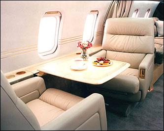 Sitting area onboard a luxury jet .