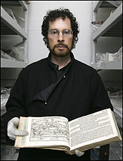 Jeffrey Forgeng of the Higgins Armory Museum brandishes Joachim Meyer's 1600 treatise ''The Art of Combat'' (detail at left).