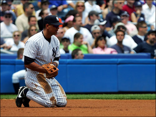 Alex Rodriguez kneels on the infield after a Manny Ramirez single sneaks past his glove. A-Rod had two hits and a walk for the Yankees in a losing effort.