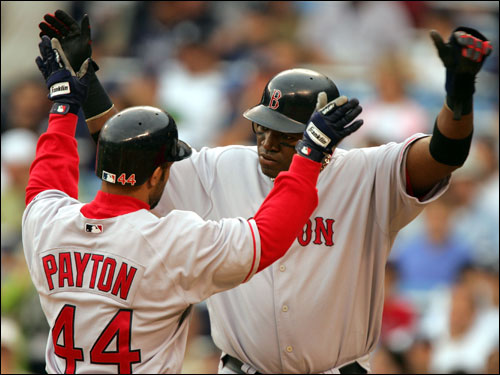 Jay Payton and David Ortiz celebrate Payton's two-run homer in the seventh inning. Payton knocked in two RBIs while Ortiz had two hits and scored three times.