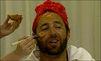 Kevin Millar enjoys getting his face slathered with a pumpkin mask.