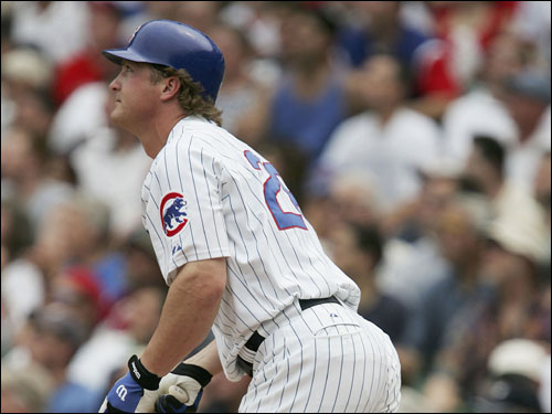 Todd Hollandsworth of the Cubs watches the flight of his two-run home run in the second inning.