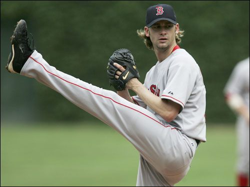 Sox starting pitcher Bronson Arroyo prepares to deliver the ball against the Cubs.