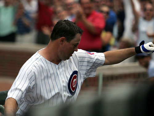 Starting pitcher Greg Maddux of the Cubs acknowledges the crowd after hitting a solo home run in the sixth inning.