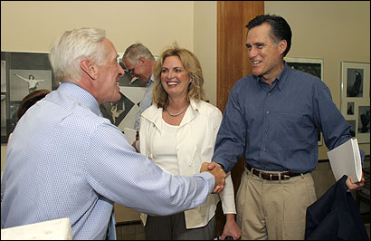 Governor Mitt Romney and his wife, Ann, met another Cranbrook School alumnus, Heisman Trophy winner and Citigroup executive Pete Dawkins.