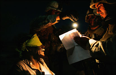 Members of the Third Battalion, Fourth Marines, detained and blindfolded a man near Fallujah yesterday. When Marines conduct raids of Iraqi homes, women must be part of the force because they are needed to conduct searches of females.