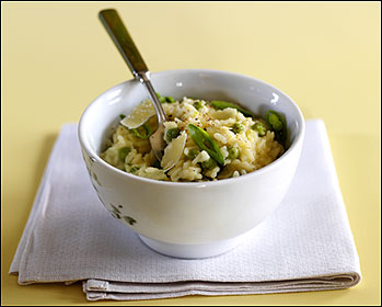 Make-ahead risotto includes fresh peas and Parmesan cheese.