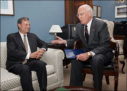 Patrick J. Leahy of Vermont (right), ranking Democrat on the Judiciary Committee, talked yesterday with John G. Roberts Jr.