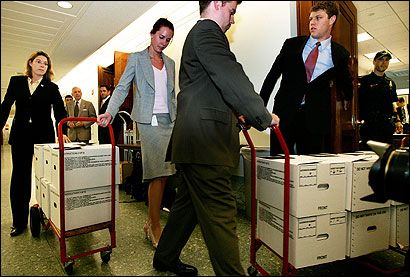 Justice Department staff arrived on Capitol Hill with documents related to John G. Roberts Jr.
