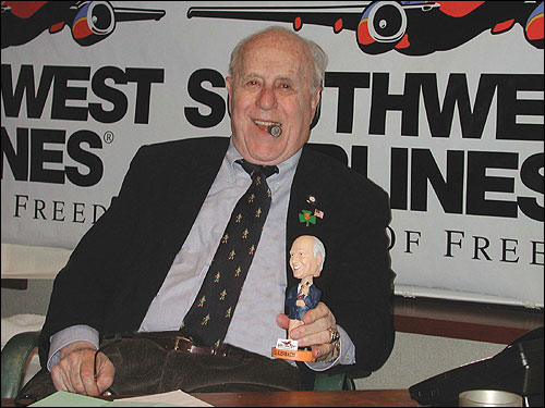 Red Auerbach struck a pose with his own bobblehead doll in March 2003, when the Celtics gave out the bobbleheads to fans before a game at the FleetCenter.
